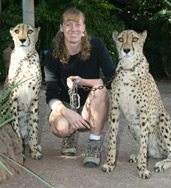 Photo of Christine Llewellyn with 2 cheetahs