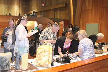 Guests taking in the silent auction items during the 2015 fundraiser for the Wildcat Education and Conservation Fund
