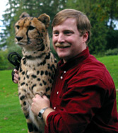 Photo of Steve Flaherty with a cheetah